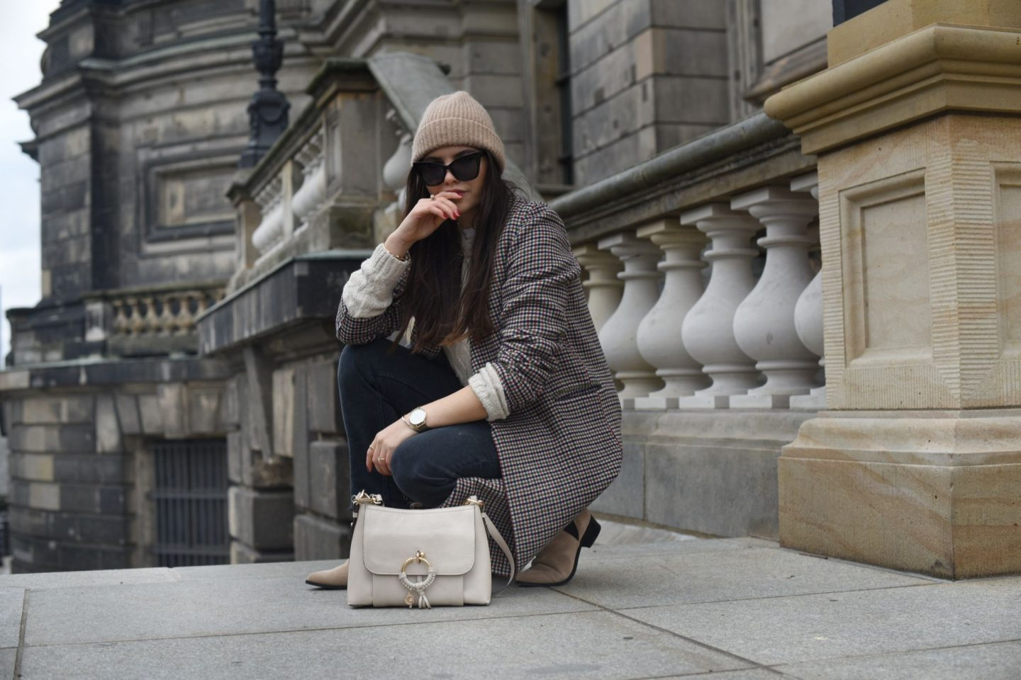 beige colored look with a checked coat